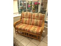WICKER CONSERVITORY CANE SETTEE SPACE NEEDED GOOD CONDITION.