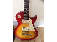PERFECT CONDITION ENCORE SUNRISE COLOURED ELECTRIC GUITAR WITH AMP FOR SALE £60