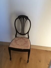 Dainty dark wood chair