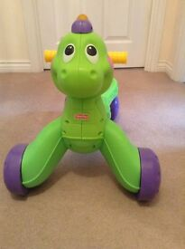 Fisher price dinosaur ride along