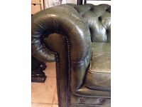 Beautiful forest green leather chesterfield sofa