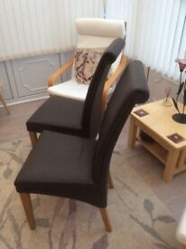 Pair of leather scroll back dining chairs