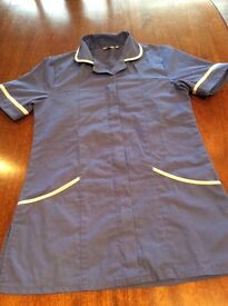 Sky blue work wear tunics in various sizes. Perfect condition