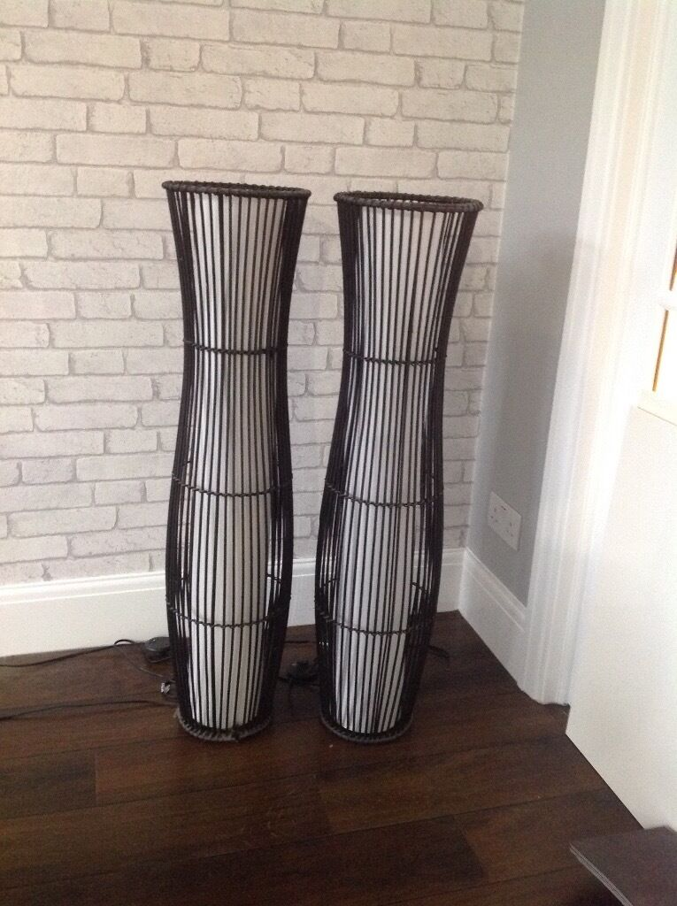 Two Brown Rattan Sculpture Floor Lamps