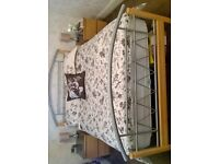 Lovely solid double bed for sale in great condition, pine wood and ornate silver.