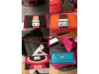 Brand new purses in boxes