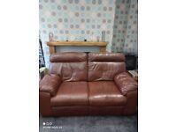 Brown 2 seater manual recliner sofa