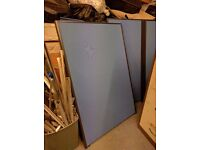 Desk dividing screens in blue, can also be used for notice boards.