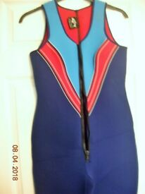 Unused. Ladies size UK 14 Long John Wet suit, thick neoprene double stitched etc. Very Good quality