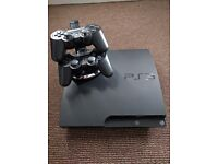 300GB PS3 - 2 Controllers with charging stand - 12 Games incl GTA V and Skyrim