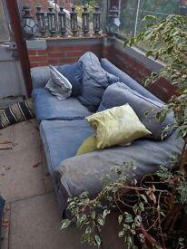 Used comfortable blue sofa.
