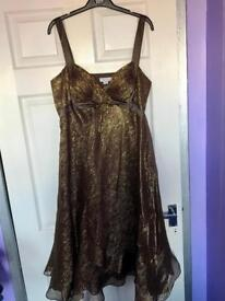 Dress Size 14 as new condition.