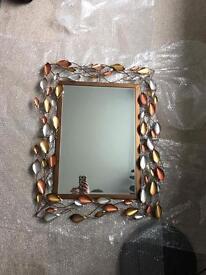 Metal leaf mirror