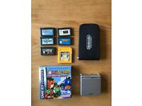 Gameboy advance SP with 6 games (including Mario kart, super Mario world, Yoshi's Island)