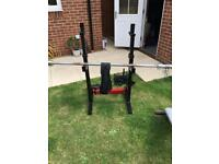 Olympic weight lifting bar, squat rack, sled and Weights
