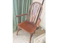 Pair of matching antique wheelback carver chairs