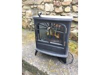 Electric effect wood burning stove