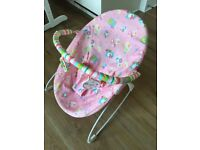 Pink baby bouncer chair - LOVED by my little girl, but still in perfect condition.