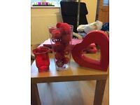 Bundle of home decor items in red