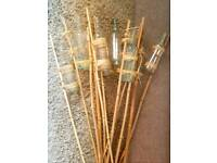 11 clear bottles on canes, ideal for wedding or event decoration