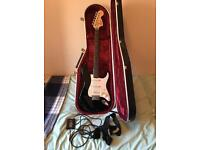 fender electric guitar and case