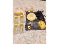 Medela Swing Electric Breast Pump and Extras