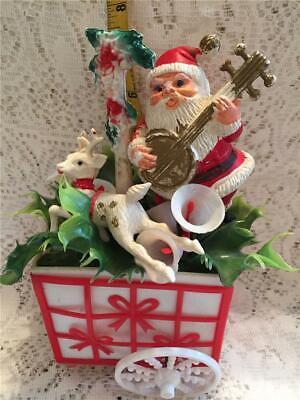 "Vintage Plastic Blowmold 8"" x 4"" Santa in Cart Playing Banjo Reindeer & Greenery"