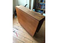 Lovely vintage wooden fold out table.