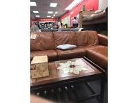 Tan leather corner suite and two seater setting