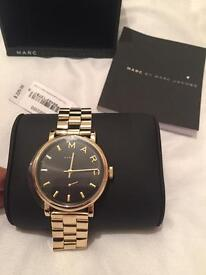 Marc Jacobs gold and black original watch ladies.