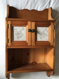 Cupboard. Wall hanging. Pine, with feature tile doors.
