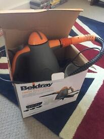 Barely used steam cleaner with accessories