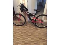 Ladies mountain bike . Dual suspension 18 speed 24inch