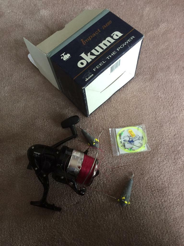 Okuma. Im80 fixed spool fishing reel and weighs. Unused