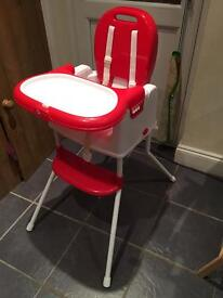 Red and white plastic infant/toddler high chair
