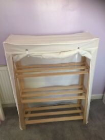 Storage unit with fabric cover