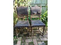 Two old leather chairs need repairing