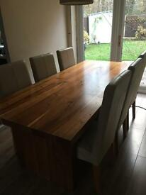 SOLD. Oak dining table with six cream leather chairs