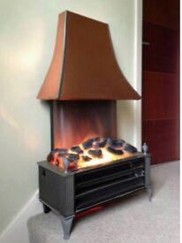 Sub house coal effect electric fire with copper canopy.
