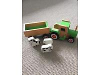 Wooden tractor with farm yard animals