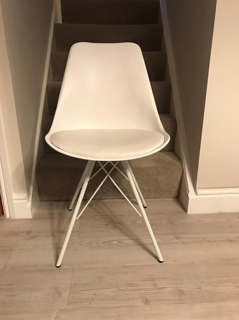 3 X White Eames Eiffel chairs with seat pads.