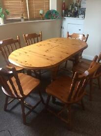 Solid pine dining table & 6 chairs. Great condition.