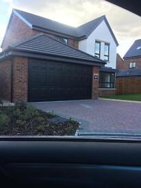 Double garage door only fitted 2 weeks