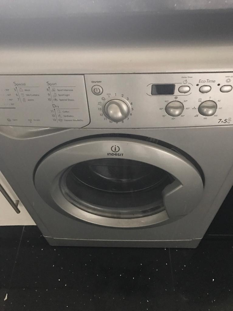 Silver washing machine/tumble dryer