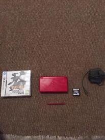 Red Nintendo DS lite with Pokemon diamond and white