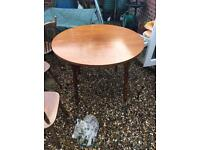 Round solid wooden table with 4 chairs