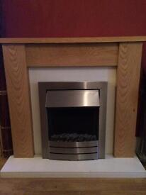 Oak fire surround and electric fire