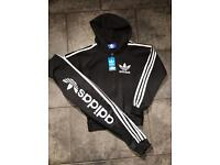 Adidas tracksuit size 7-8years