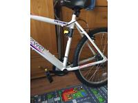 "Brand new ladies mountain bike 20"" frame. Child's seat and bracket"