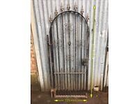Pedestrian wrought iron gate with hinge plate.